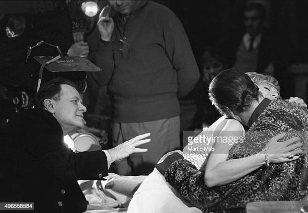 Actress and singer Edie Adams embraces actor Rex Harrison directed by Joseph L Mankiewicz on the set of the Famous Artists Productions film 'The...