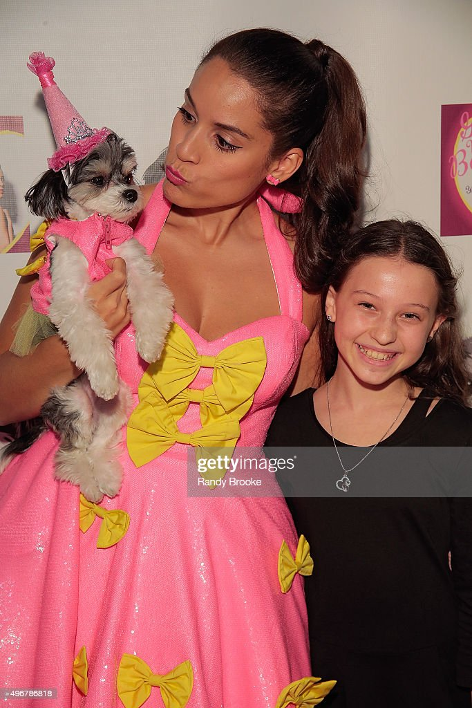 Actress and Singer Gina Naomi Baez poses with Mia LePage during the Andi Dorfman Celebrates Tinkerbelle The Dog's Birthday at Inglot Cosmetics on November 11, 2015 in New York City.
