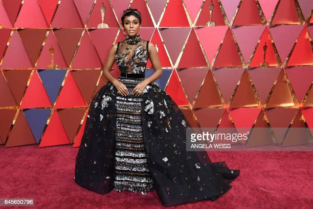 US actress and singer Janelle Monae poses as she arrives on the red carpet for the 89th Oscars on February 26 2017 in Hollywood California / AFP /...