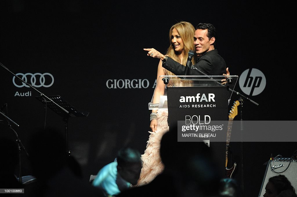 US actress and singer Jennifer Lopez and Mexican singer Marc Anthony lead an auction at amfAR's Cinema Against Aids 2010 benefit gala on May 20, 2010 in Antibes, southeastern France.