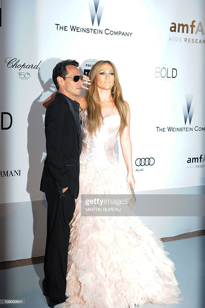 US actress and singer Jennifer Lopez and Mexican singer Marc Anthony pose while arriving to attend the 2010 amfAR's Cinema Against Aids on May 20, 2010 in Antibes, southeastern France.