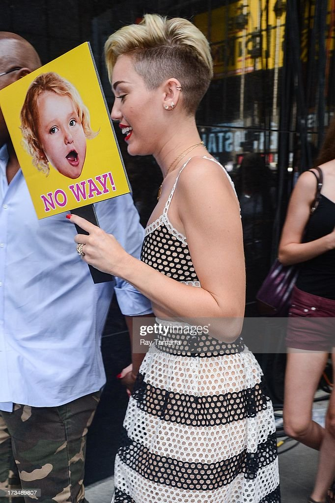 Actress and singer Miley Cyrus leaves the 'Good Morning America' taping at the ABC Times Square Studios on July 15, 2013 in New York City.