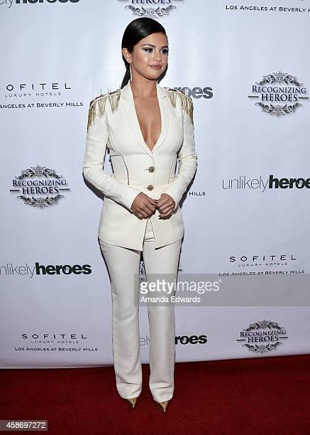 Actress and singer Selena Gomez arrive at the 3rd Annual Unlikely Heroes Awards Dinner and Gala at the Sofitel Hotel on November 8 2014 in Los...