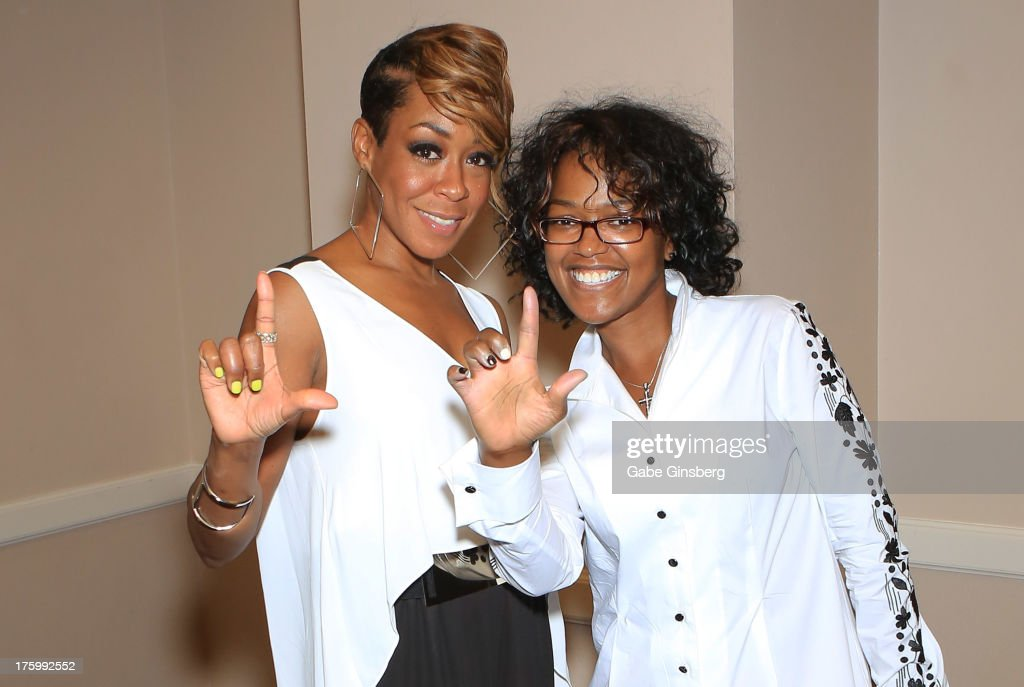 Actress and singer Tichina Arnold (L) and her sister Zenay Arnold attend the 11th annual Ford Neighborhood Awards at the MGM Grand Garden Arena on August 10, 2013 in Las Vegas, Nevada.