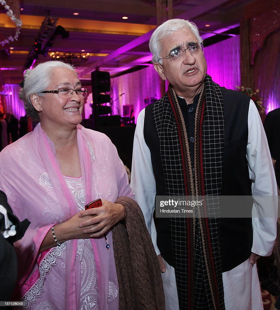 Actress and social activist Nafisa Ali (L) and Indian politician Salman Khurshid (R) attending the marriage reception of YES Bank founder Rana Kapoor's daughter at Taj Palace on November 30, 2012 in New Delhi, India. Kapoor is the MD & CEO of YES Bank, which is the 4th largest private sector bank in the country.
