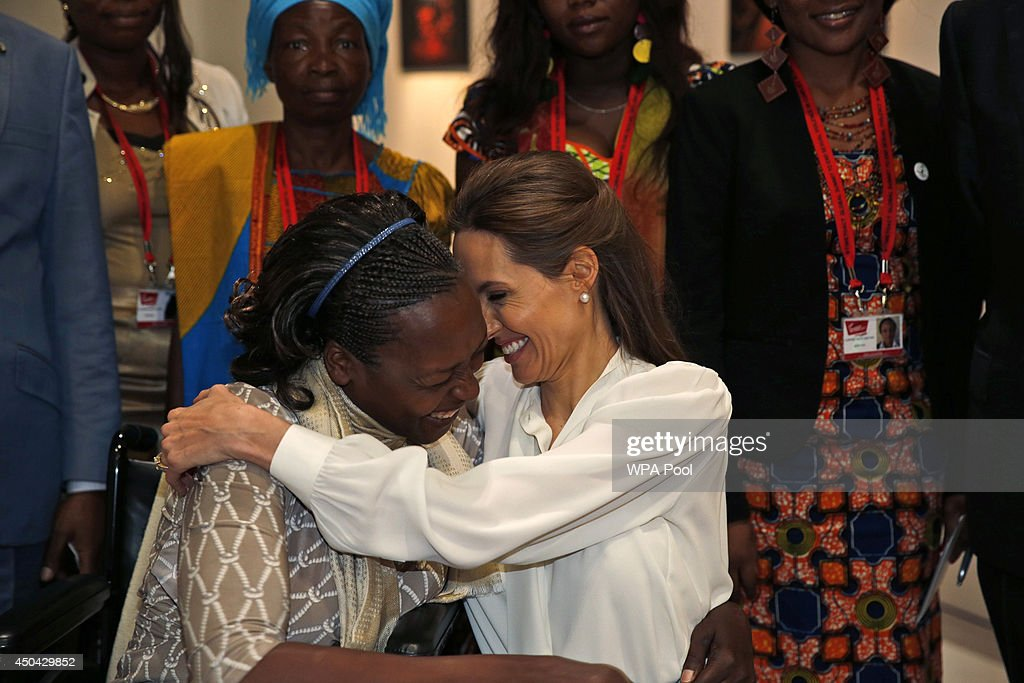 US Actress and Special Envoy of the United Nations High Commissioner for Refugees, <a gi-track='captionPersonalityLinkClicked' href=/galleries/search?phrase=Angelina+Jolie&family=editorial&specificpeople=201591 ng-click='$event.stopPropagation()'>Angelina Jolie</a> hugs Neema Namadamu of the Democratic Republic of Congo at the 'End Sexual Violence in Conflict' summit at ExCel on June 11, 2014 in London, England. Namadamu formed an organization that uses digital media to empower women demanding peace in eastern Congo. She formed it earlier this year after her own 25-year -old daughter was attacked. The Summit welcomes governments from over 100 countries, over 900 experts, NGOs, Faith leaders, and representatives from international organisations across the world.