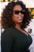Actress and TV personality Oprah Winfrey poses during red carpet arrivals for the Critic's Choice Awards in Santa Monica California on January 16...