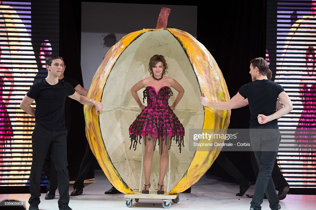 Actress and TV presenter Annabelle Milot walks the runway and wears 'La Deesse Chocolatee', a chocolate dress made by designer Nathalie Vigne and chocolate maker Francois Pralus, during the Fashion Chocolate Show at Salon du Chocolat at Porte de Versailles, in Paris.