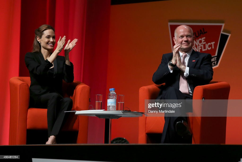Actress and UN special envoy <a gi-track='captionPersonalityLinkClicked' href=/galleries/search?phrase=Angelina+Jolie&family=editorial&specificpeople=201591 ng-click='$event.stopPropagation()'>Angelina Jolie</a> and Britain's Foreign Secretary <a gi-track='captionPersonalityLinkClicked' href=/galleries/search?phrase=William+Hague&family=editorial&specificpeople=206295 ng-click='$event.stopPropagation()'>William Hague</a> attend the Global Summit to end Sexual Violence in Conflict at ExCel on June 12, 2014 in London, England.