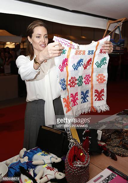US actress and UN special envoy Angelina Jolie looks at products made by women and sold by the International Campaign to Stop Rape and Gender...