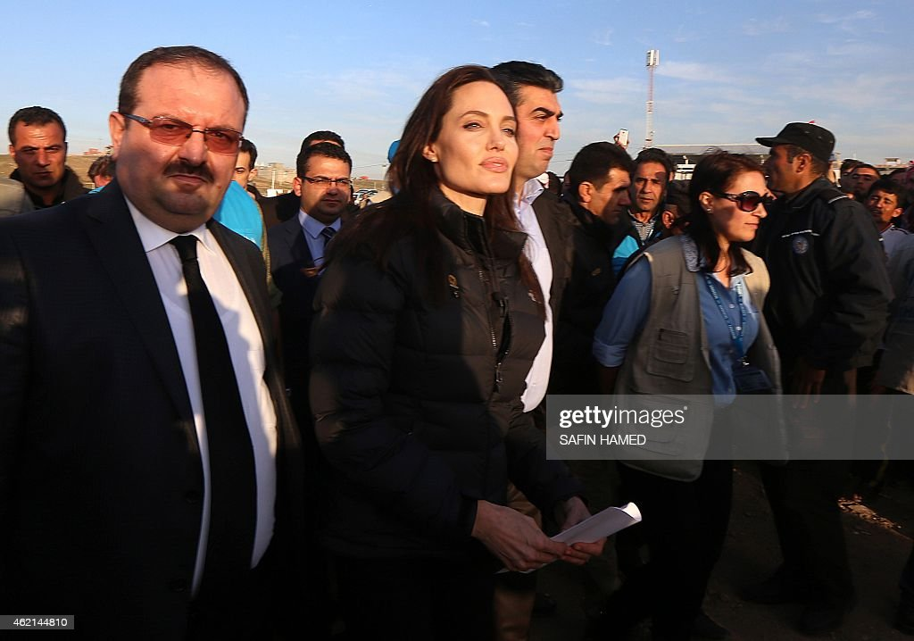 US actress and UNHCR ambassador <a gi-track='captionPersonalityLinkClicked' href=/galleries/search?phrase=Angelina+Jolie&family=editorial&specificpeople=201591 ng-click='$event.stopPropagation()'>Angelina Jolie</a> (C) arrives for a visit to a camp for displaced Iraqis in Khanke, a few kilometres (miles) from the Turkish border in Iraq's Dohuk province, on January 25, 2015. Run by authorities from the three-province autonomous Kurdish region of north Iraq with the help of the United Nations refugee agency, the UNHCR, Khanke aims to house 18,000 people, said the agency's Liena Veide.
