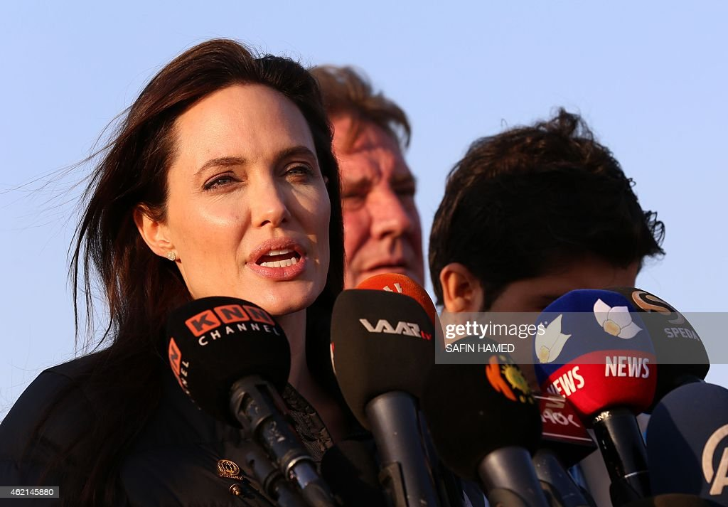 US actress and UNHCR ambassador Angelina Jolie delivers a speech during a visit to a camp for displaced Iraqis in Khanke a few kilometres from the...