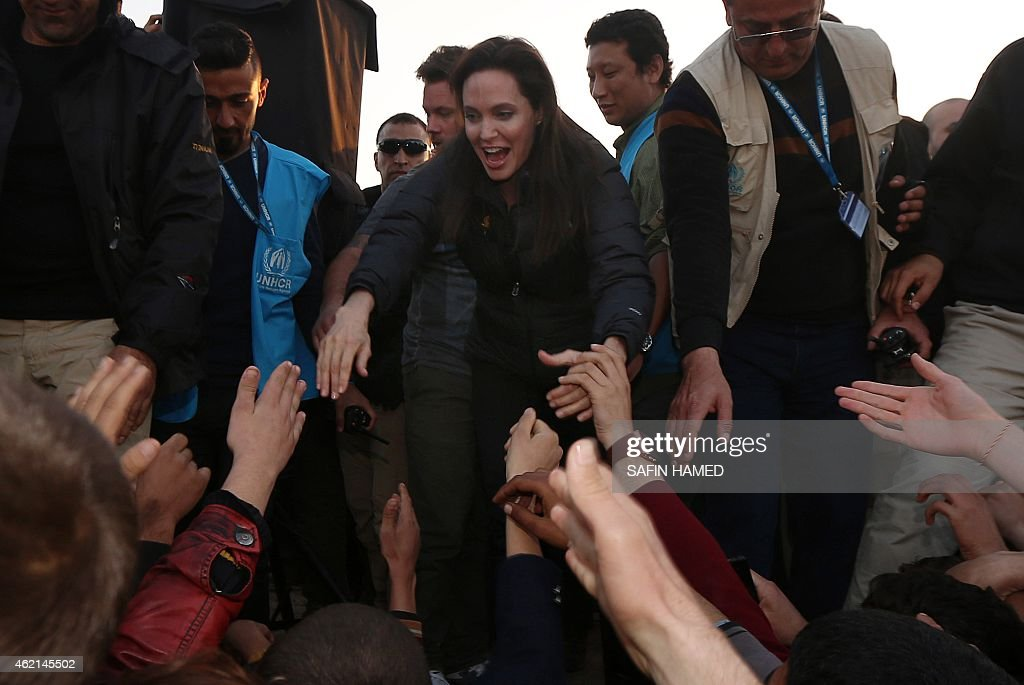 US actress and UNHCR ambassador Angelina Jolie greets displaced Iraqi children during a visit to a camp for displaced people in Khanke a few...