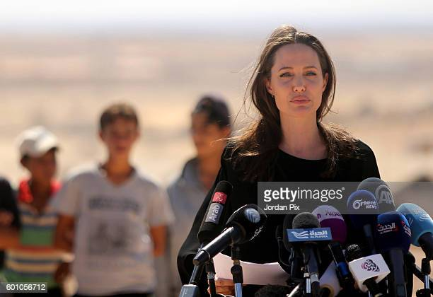 US actress and UNHCR special envoy and Goodwill Ambassador Angelina Jolie speaks during a press conference at Al Azraq camp for Syrian refugees on...