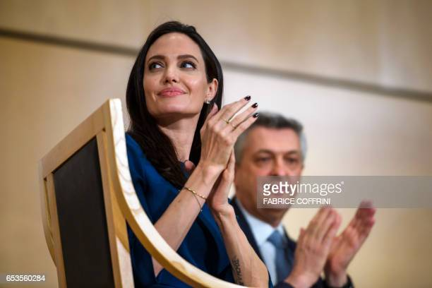 US actress and United Nations High Commissioner for Refugees special envoy Angelina Jolie sits next to United Nations High Commissioner for Refugees...
