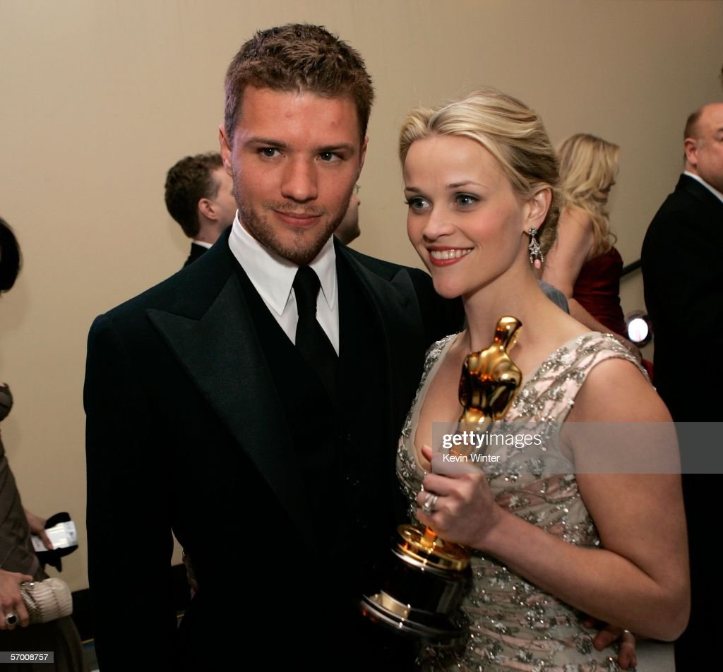 Actress and winner Reese Witherspoon poses with her Oscar and husband Ryan Phillippe (L) as they attend the Governor's Ball after the 78th Annual Academy Awards at The Highlands on March 5, 2006 in Hollywood, California.
