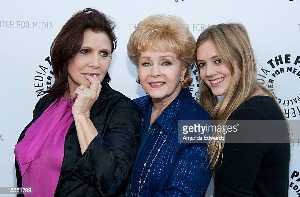 Actress and writer Carrie Fisher her mother Debbie Reynolds and daughter Billie Lourd arrive at The Paley Center For Media TCM Present Debbie...