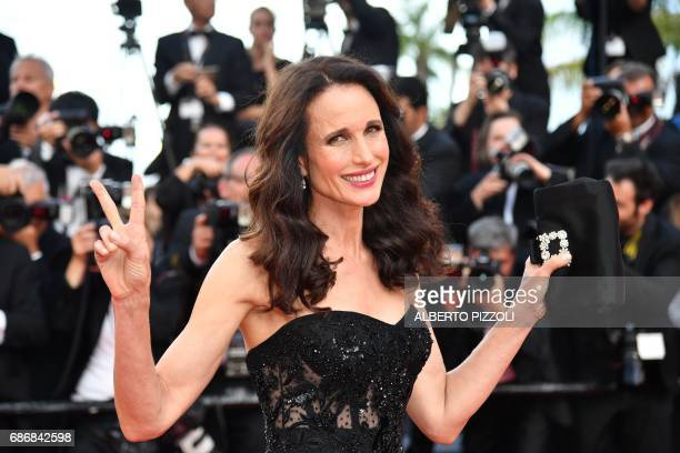 US actress Andie MacDowell poses as she arrives on May 22 2017 for the screening of the film 'The Killing of a Sacred Deer' at the 70th edition of...