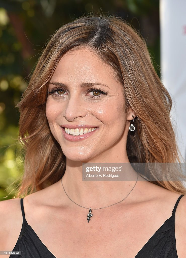 Actress <a gi-track='captionPersonalityLinkClicked' href=/galleries/search?phrase=Andrea+Savage&family=editorial&specificpeople=2868234 ng-click='$event.stopPropagation()'>Andrea Savage</a> arrives to the premiere of Hulu's 'The Hotwives of Orlando' at the Sherry Lansing Theatre at Paramount Studios on July 8, 2014 in Los Angeles, California.