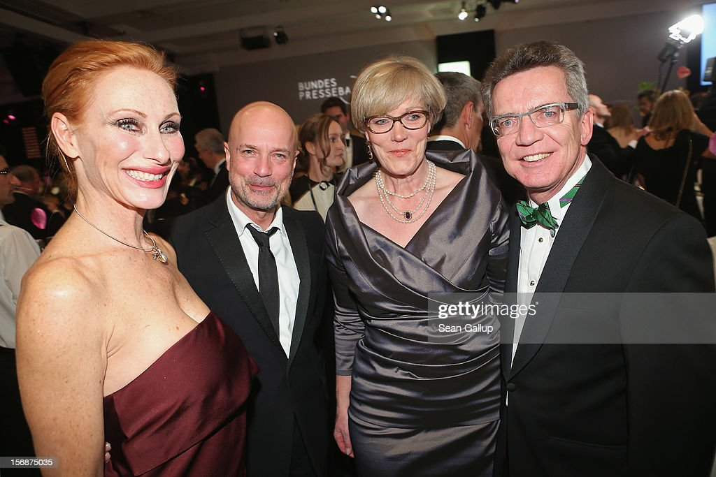 Actress Andrea Sawatzki, actor Christian Berkel, Martina de Maiziere and German Defense Minister Thomas de Maiziere attend the 2012 Bundespresseball (Federal Press Ball) at the Intercontinental Hotel on November 23, 2012 in Berlin, Germany.