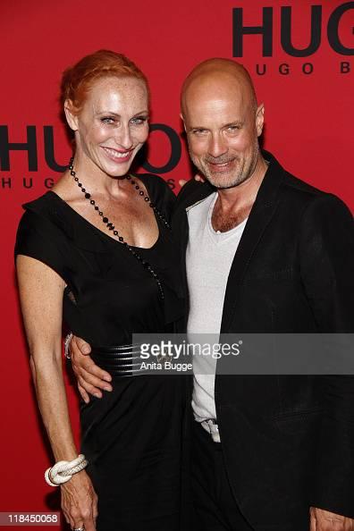 Actress Andrea Sawatzki and her husband actor Christian Berkel attend the Hugo Show during MercedesBenz Fashion Week Berlin Spring/Summer 2012 at the...