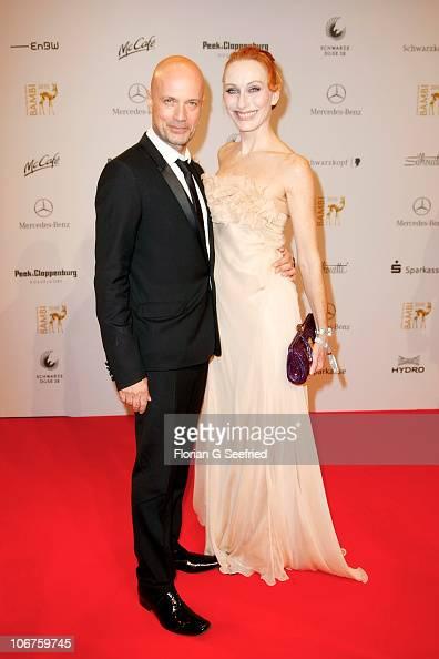 Actress Andrea Sawatzki and husband Christian Berkel pose on the red carpet for the Bambi 2010 Award at Filmpark Babelsberg on November 11 2010 in...