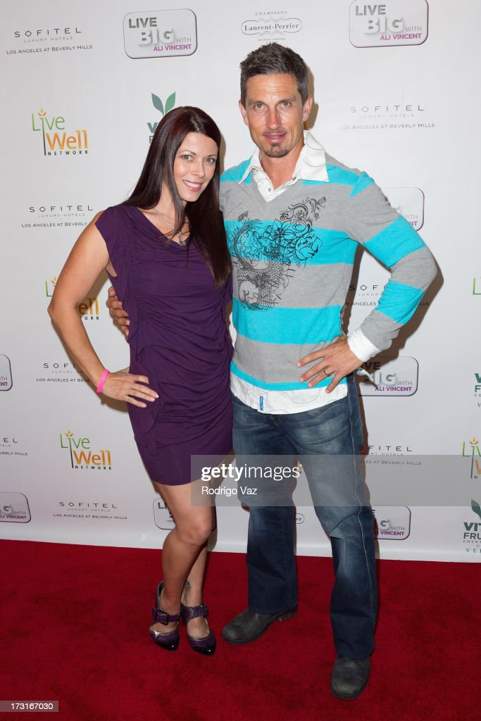 Actress Angel Boris (L) and TV personality Marco Reed arrive at 'Live Big With Ali Vincent' Season 3 launch party at Sofitel Hotel on July 8, 2013 in Los Angeles, California.
