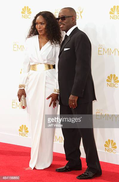 Actress Angela Bassett and actor Courtney B Vance attend the 66th Annual Primetime Emmy Awards held at Nokia Theatre LA Live on August 25 2014 in Los...