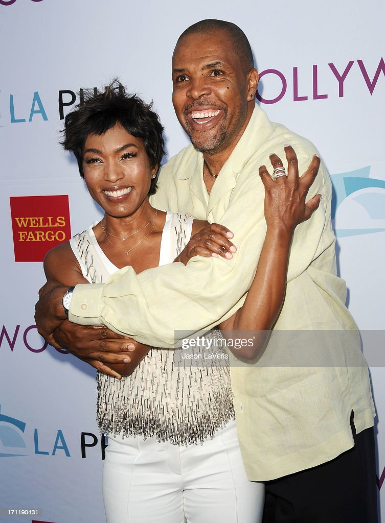 Actress Angela Bassett and actor Eriq La Salle attend the Hollywood Bowl opening night celebration at The Hollywood Bowl on June 22, 2013 in Los Angeles, California.