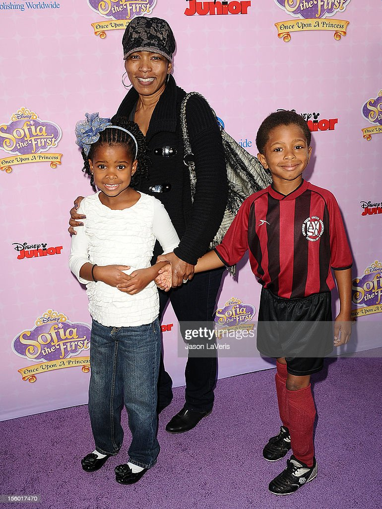 Actress Angela Bassett and children Bronwyn Golden Vance (L) and Slater Josiah Vance (R) attend the premiere of 'Sofia The First: Once Upon a Princess' at Walt Disney Studios on November 10, 2012 in Burbank, California.