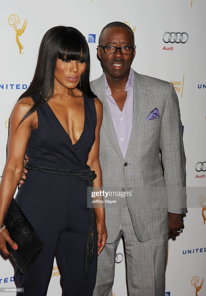 Actress Angela Bassett (L) and Courtney B. Vance arrive at the Television Academy's 66th Emmy Awards Performance Nominee Reception at the Pacific Design Center on Saturday, Aug. 23, 2014, in West Hollywood, California.