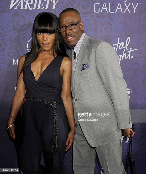 Actress Angela Bassett and Courtney B Vance arrive at the Variety And Women In Film Annual PreEmmy Celebration at Gracias Madre on August 23 2014 in...