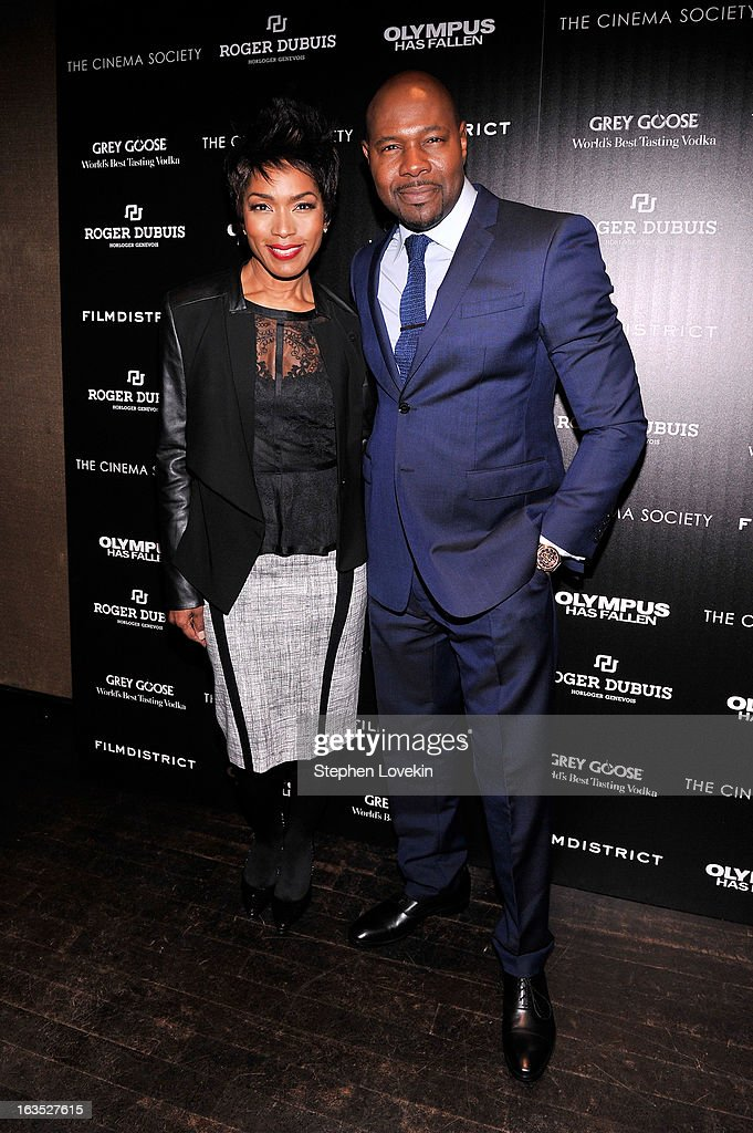 Actress Angela Bassett and director Antoine Fuqua attend The Cinema Society with Roger Dubuis and Grey Goose screening of FilmDistrict's 'Olympus Has Fallen' at Tribeca Grand Hotel on March 11, 2013 in New York City.