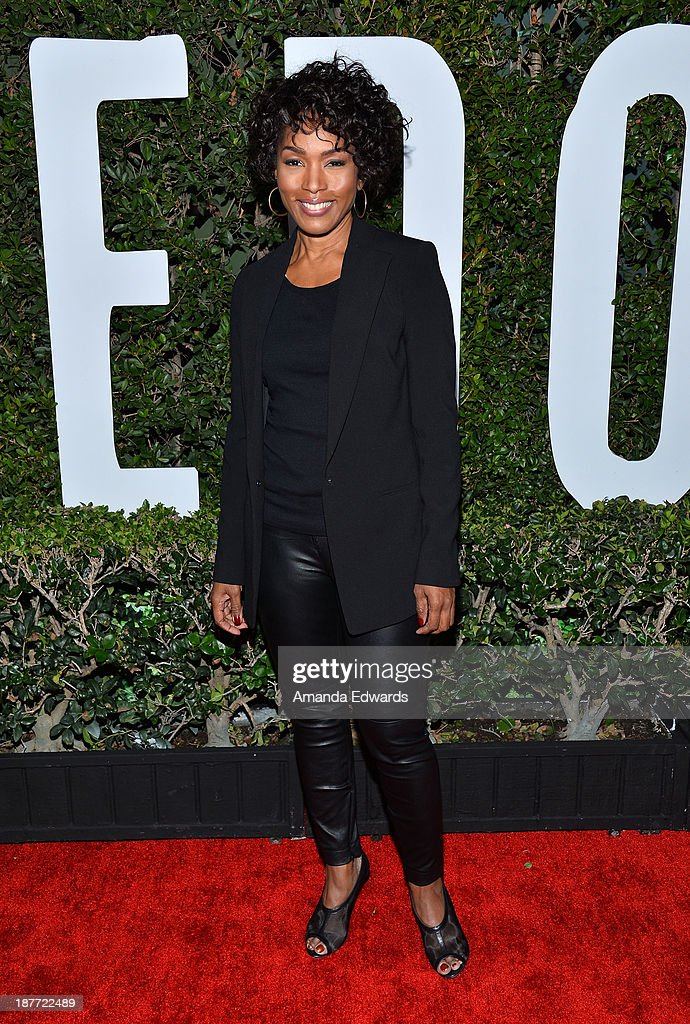 Actress Angela Bassett arrives at the Los Angeles premiere of 'Mandela: Long Walk To Freedom' at ArcLight Cinemas Cinerama Dome on November 11, 2013 in Hollywood, California.
