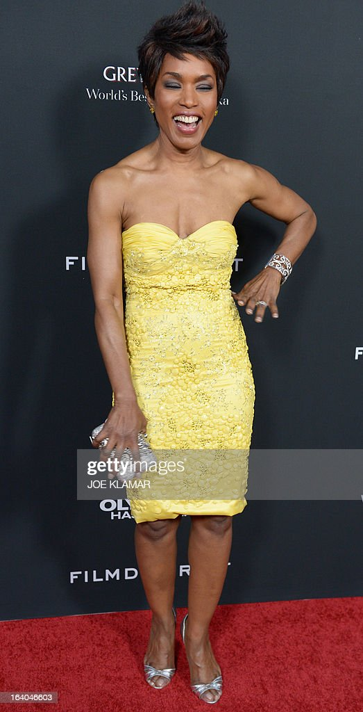 Actress Angela Bassett arrives at the premiere of FilmDistrict's 'Olympus Has Fallen' at ArcLight Cinemas Cinerama Dome on March 18, 2013 in Hollywood, California.