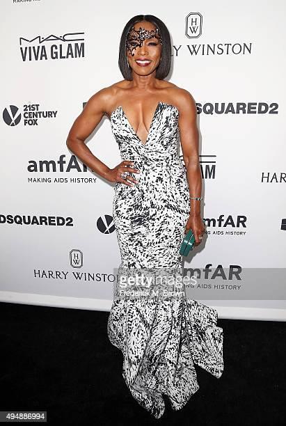 Actress Angela Bassett attends amfAR's Inspiration Gala Los Angeles at Milk Studios on October 29 2015 in Hollywood California