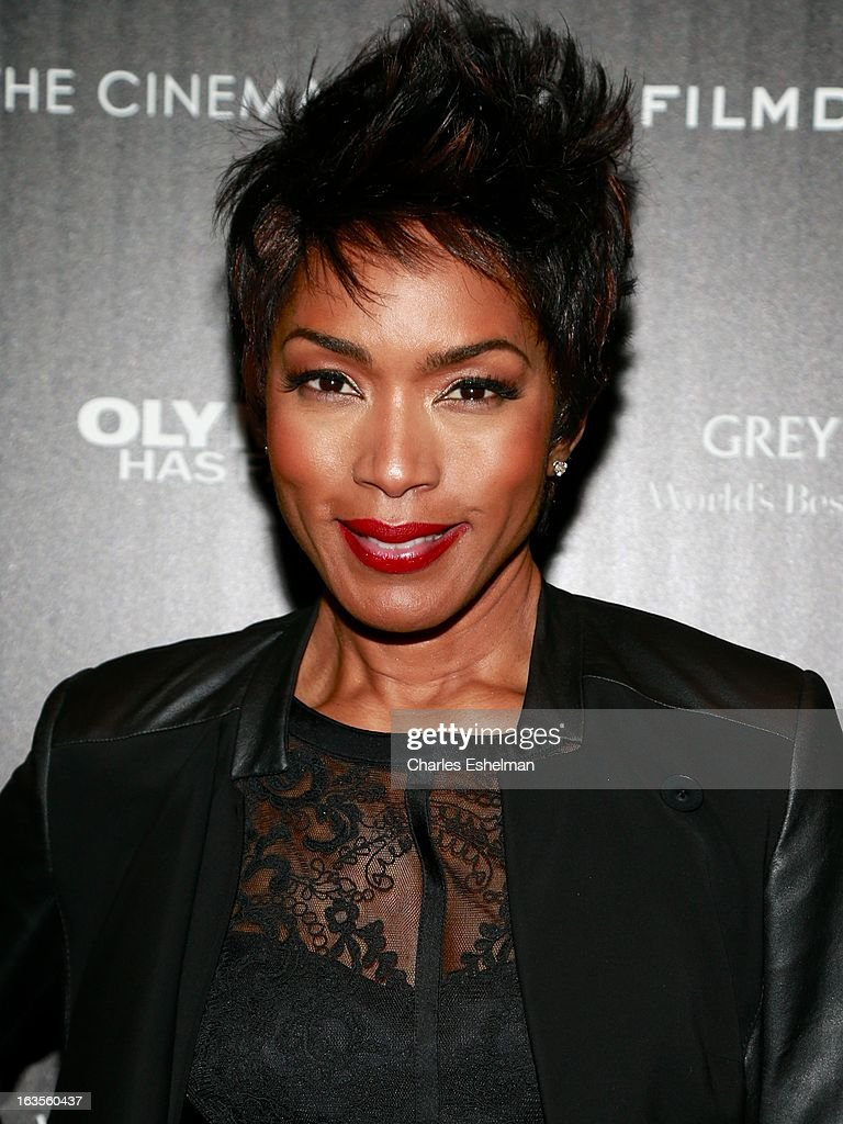 Actress Angela Bassett attends The Cinema Society with Roger Dubuis and Grey Goose screening of FilmDistrict's 'Olympus Has Fallen' at the Tribeca Grand Screening Room on March 11, 2013 in New York City.
