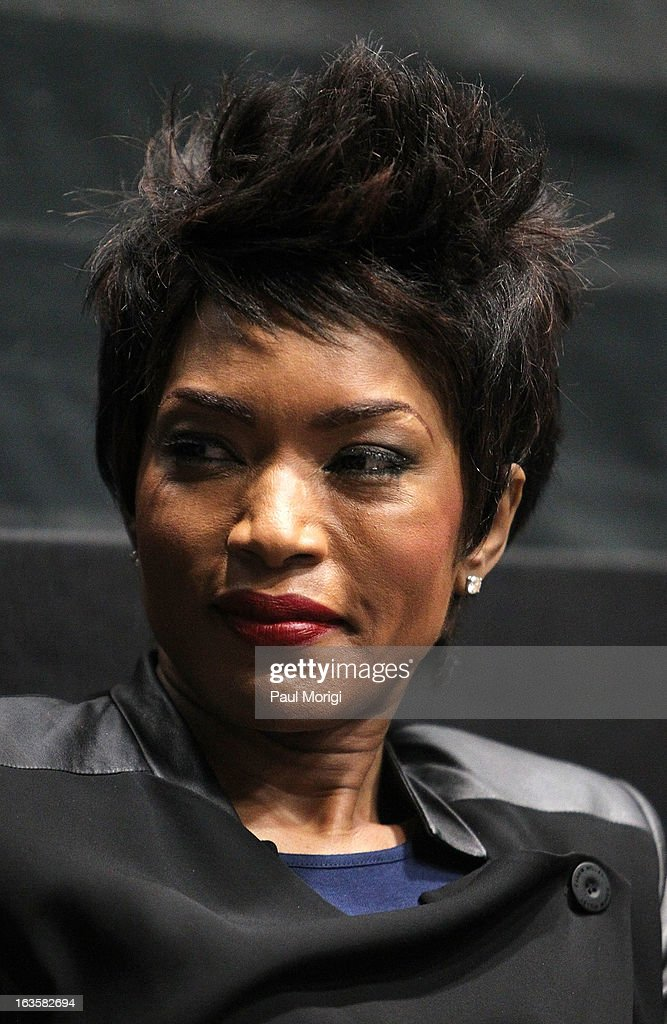 Actress Angela Bassett attends the 'Olympus Has Fallen' screening Q & A session at AMC Loews Georgetown 14 on March 12, 2013 in Washington, DC.