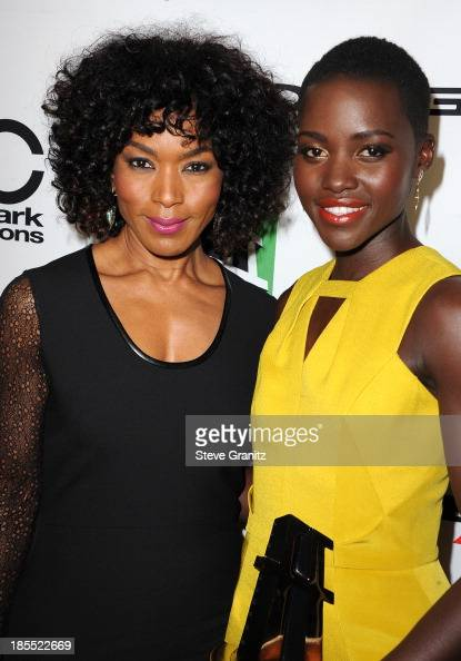 Actress Angela Bassett poses with honoree Lupita Nyong'o in the press room during the 17th Annual Hollywood Film Awards at The Beverly Hilton Hotel...