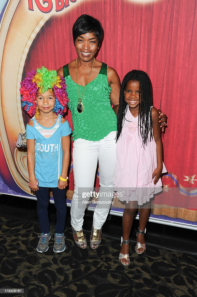 Actress Angela Bassett, son Slater Josiah (L) and daughter Brownwyn Golden attend the celebrity premiere of Ringling Bros. and Barnum & Bailey's 'Built To Amaze!' tour at Staples Center on July 11, 2013 in Los Angeles, California.