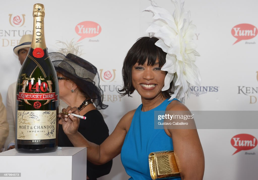 Actress <a gi-track='captionPersonalityLinkClicked' href=/galleries/search?phrase=Angela+Bassett&family=editorial&specificpeople=171174 ng-click='$event.stopPropagation()'>Angela Bassett</a> toasts with Moet & Chandon at the 140th Kentucky Derby at Churchill Downs on May 3, 2014 in Louisville, Kentucky.