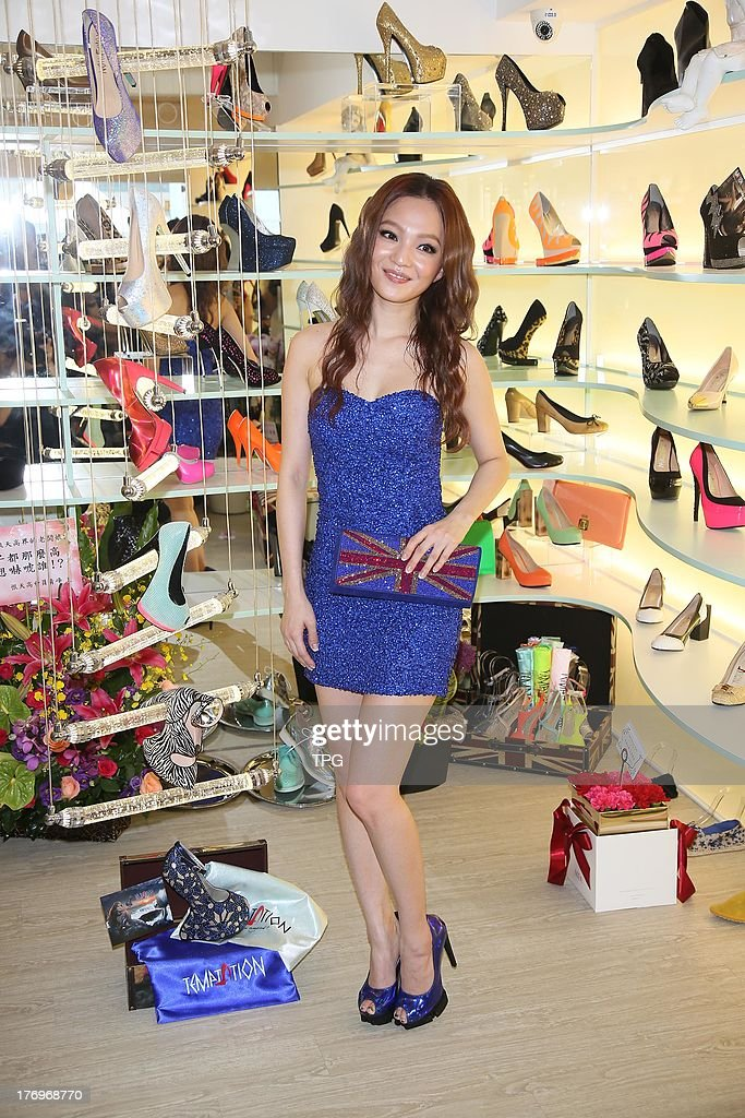 Actress Angela Chang attends the opening ceremony of her new shoe shop on Monday August 19,2013 in Taipei,China.