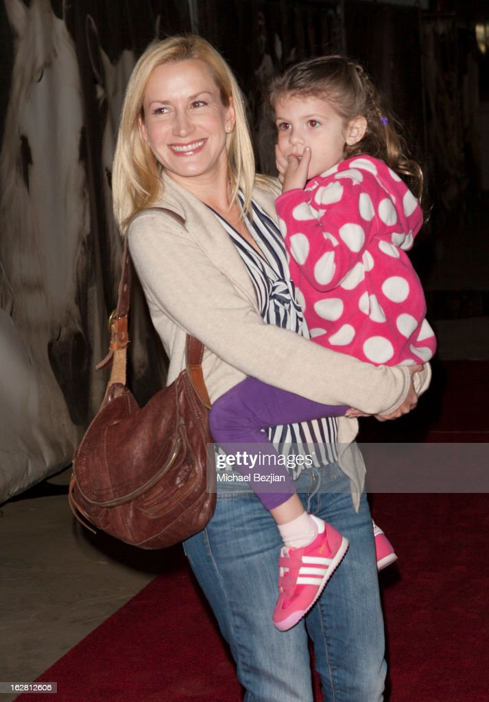 Actress <a gi-track='captionPersonalityLinkClicked' href=/galleries/search?phrase=Angela+Kinsey&family=editorial&specificpeople=743914 ng-click='$event.stopPropagation()'>Angela Kinsey</a> and daughter attend Celebrity Red Carpet Opening For Cavalia's 'Odysseo' at Cavalia's Odysseo Village on February 27, 2013 in Burbank, California.