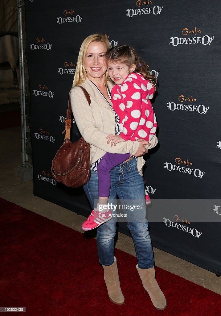 Actress <a gi-track='captionPersonalityLinkClicked' href=/galleries/search?phrase=Angela+Kinsey&family=editorial&specificpeople=743914 ng-click='$event.stopPropagation()'>Angela Kinsey</a> (L) and her daughter Isabel Ruby Lieberstein (R) attend the opening night for Cavalia's 'Odysseo' at the Cavalia's Odysseo Village on February 27, 2013 in Burbank, California.
