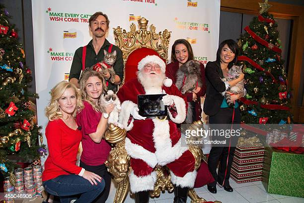 Actress Angela Kinsey Mick Szydlowski holding his cat Oskar Tabatha Bundesen holding Grumpy Cat 'Santa Claus' holding a picture of Hamilton The...