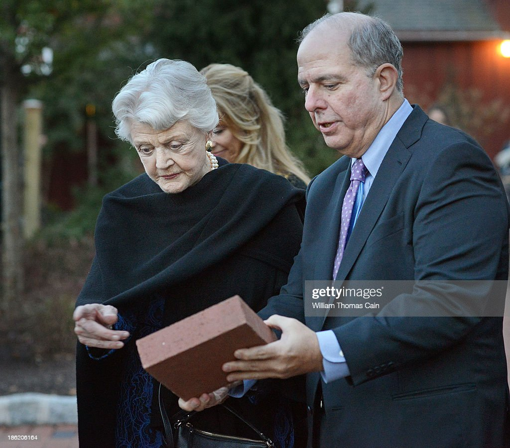 Actress Angela Lansbury is presented with a commemorative brick to be installed in the walkway by Jed Bernstein, Producing Director of the Bucks County Playhouse October 28, 2013 at the Bucks County Playhouse in New Hope, Pennsylvania. Lansbury, five-time Tony Award winning actress is the first inductee of the Bucks County Playhouse's Hall of Fame.