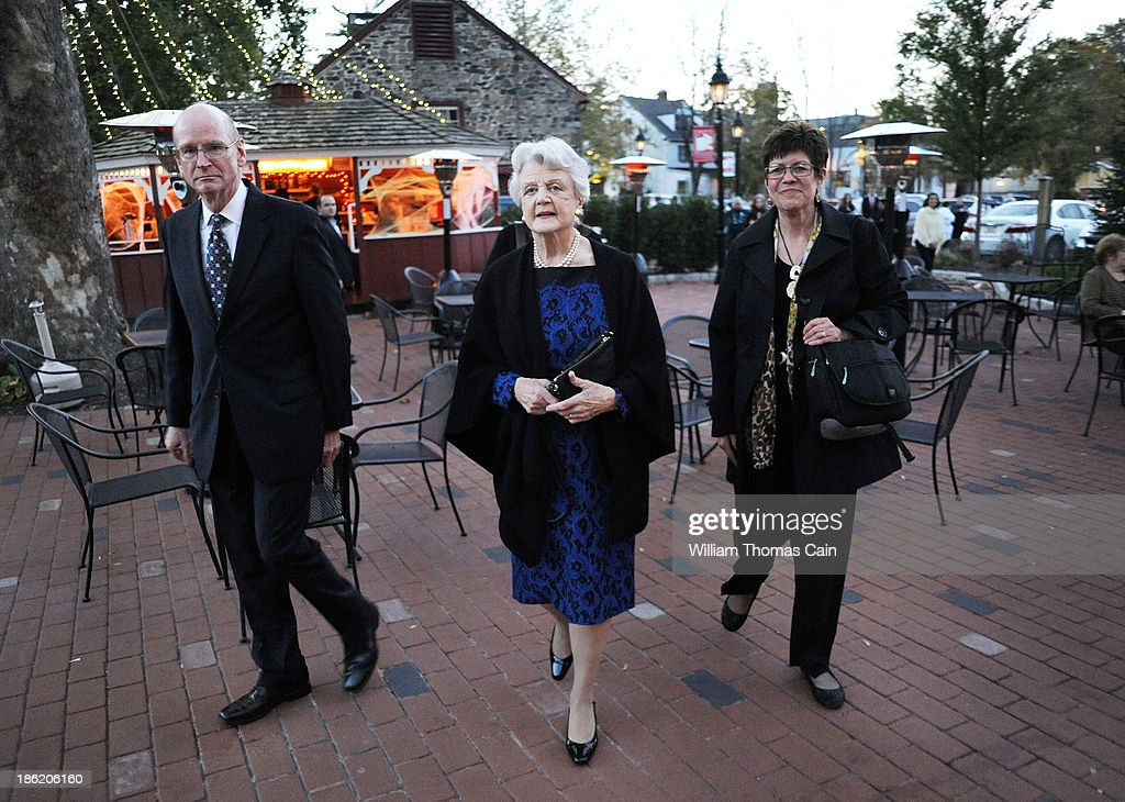 Actress Angela Lansbury walks to the theater entrance after being presented with a commemorative brick to be installed in the walkway October 28, 2013 at the Bucks County Playhouse in New Hope, Pennsylvania. Lansbury, five-time Tony Award winning actress is the first inductee of the Bucks County Playhouse's Hall of Fame.