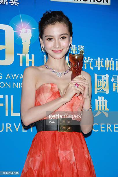 Actress Angelababy poses backstage during 2013 Huading Awards Ceremony at Kowloonbay International Trade and Exhibition Centre on April 10 2013 in...