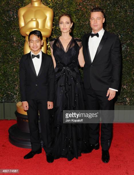 Actress Angelina Jolie actor Brad Pitt and son Maddox JoliePitt arrive at The Board Of Governors Of The Academy Of Motion Picture Arts And Sciences'...