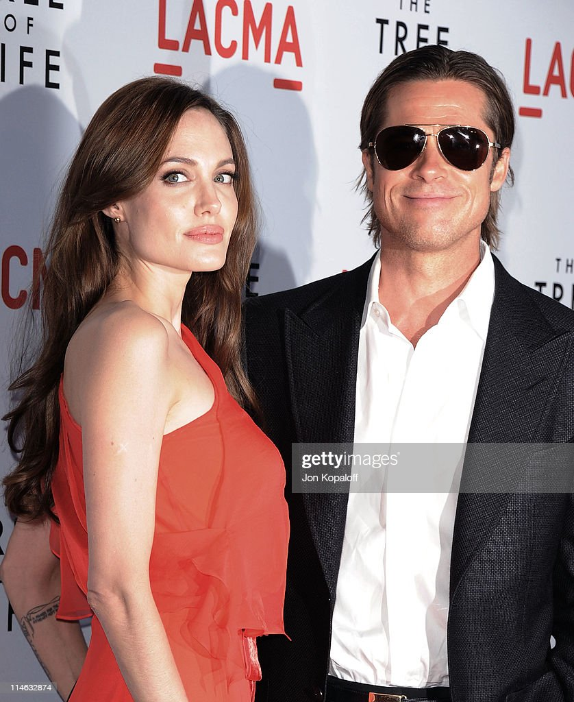 Actress Angelina Jolie and actor Brad Pitt arrive at the Los Angeles Premiere 'The Tree Of Life' at the Bing Theatre at LACMA on May 24 2011 in Los...